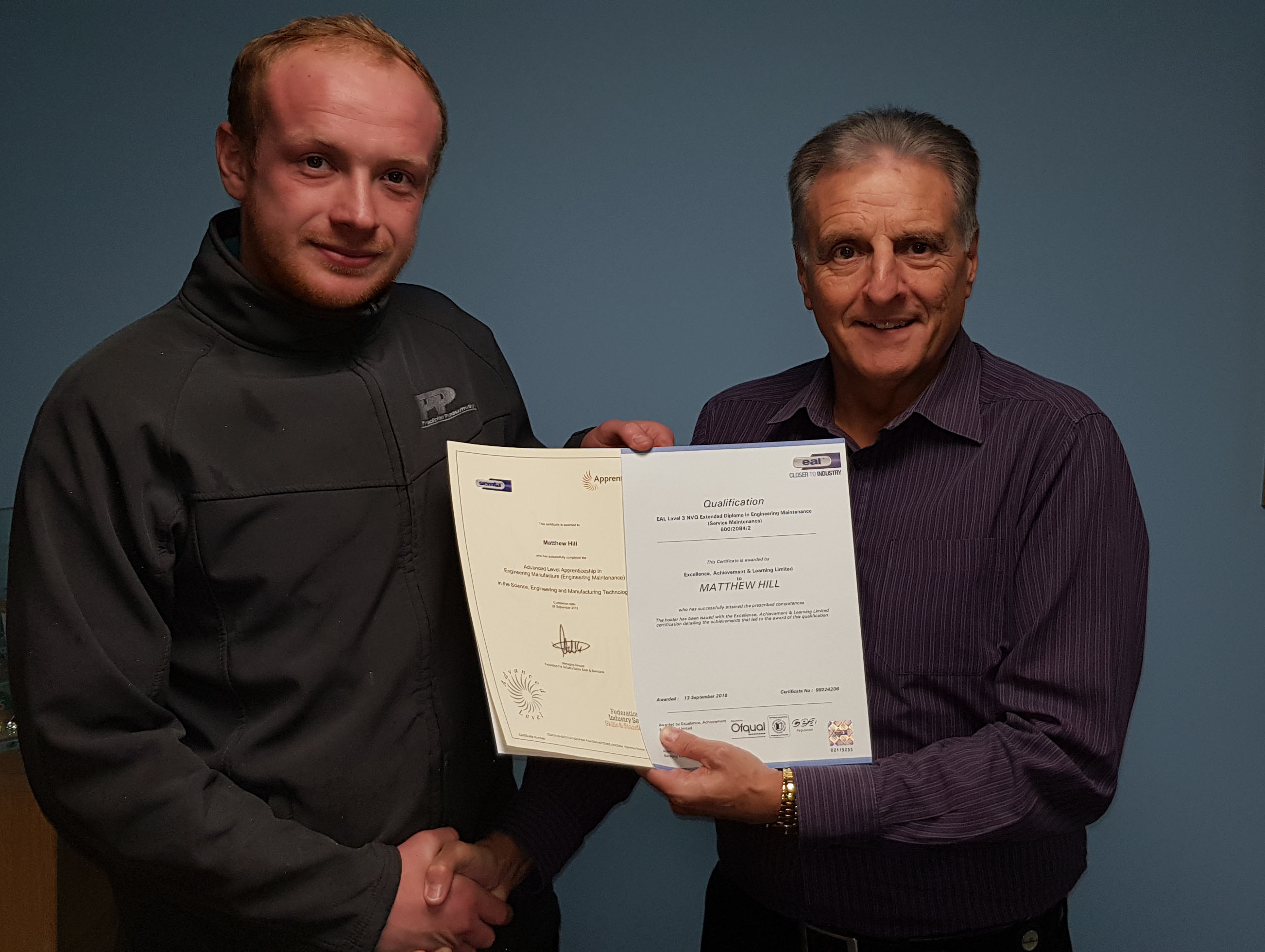 Matthew Hill receives his certificates from Managing Director Phil Hood